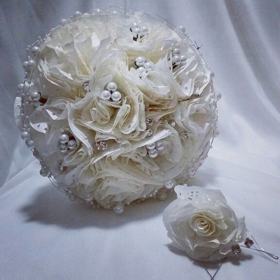 Paper doiley wedding bouquet with pearls. Featuring matching button hole.
