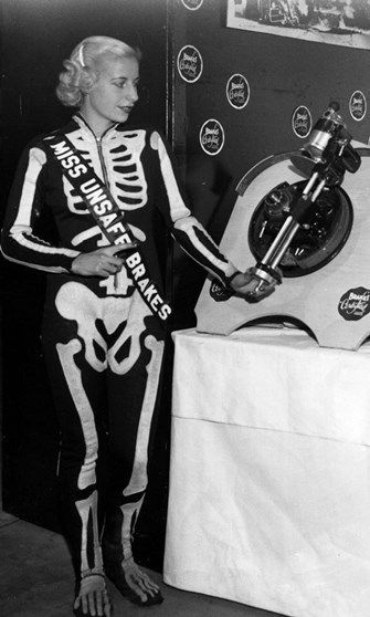 Miss Unsafe Brakes 1939, at the Chicago Auto Show in a skeleton costume, to assert the importance of brake safety.