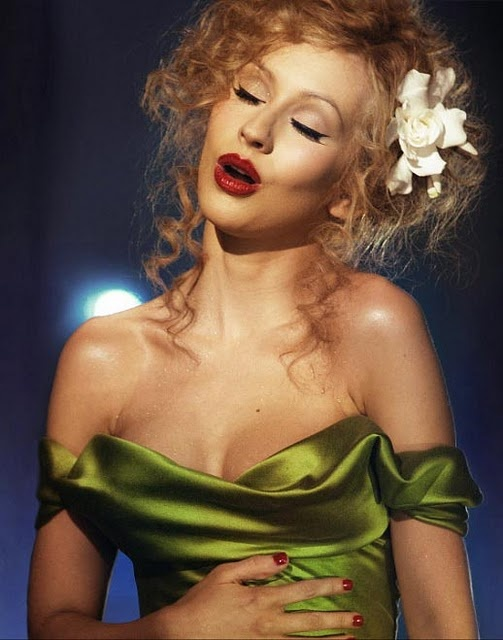 Love the Hair, Makeup, Dress, and Flower.  Absolutely nothing wrong in this photo!!! AND then her voice... PERFECT!!  Bound to You is so powerful!  Love Christina Aguilera in Burlesque!