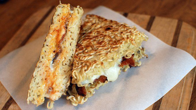 Replace the bread in a grilled cheese sandwich with ramen noodles, then add some spicy sriracha and crispy bacon, and you have a fun twist on a classic sandwich.