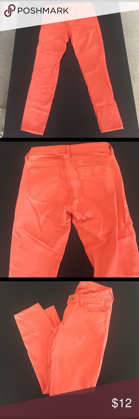 Orange cropped jeans Rock Star by Old Navy cropped jeans. Orange color makes a great outfit statement! No longer fit.  Gently worn. Tiny bleach spot on front left leg by inside seam. Price reflects this minor flaw. Says size 8 but fit more like a 4/6. Old Navy Jeans Ankle & Cropped