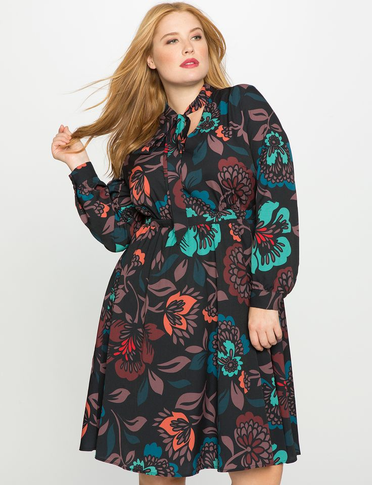 Is this Printed Tie Neck Fit and Flare Dress from Eloquii the perfect dress for fall or what?!
