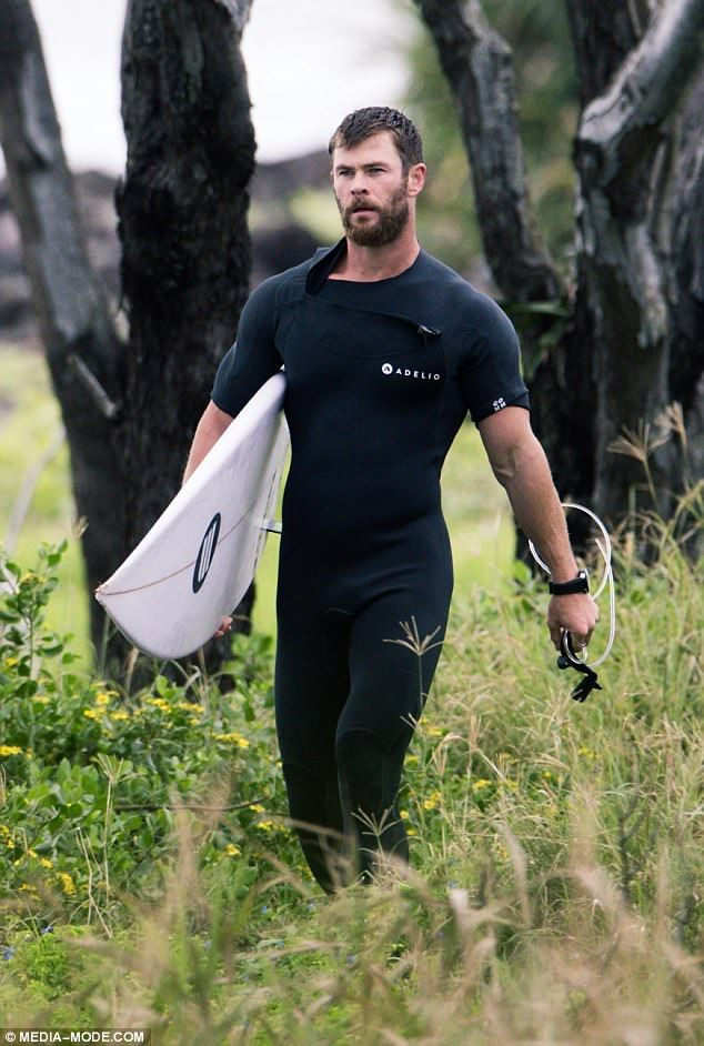 Suits you, sir! Chris Hemsworth was fresh from having a surf in Byron Bay when he ran into some  fans on Good Friday