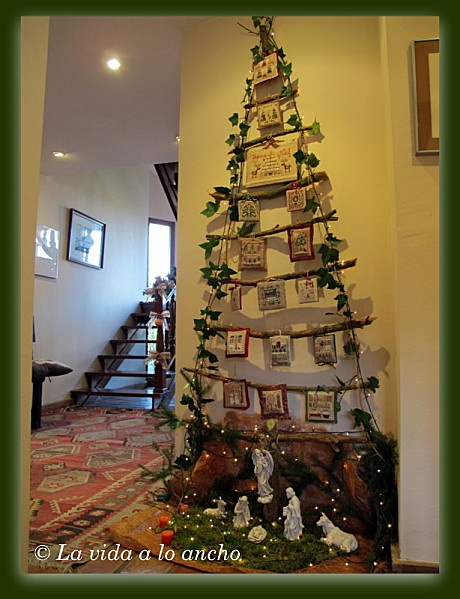 what a neat idea! ribbon stretched into a christmas tree design to display christmas cards.  decorate with an ivy garland and lights!