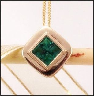 Emerald Gemstone Pendant Set in 9ct Solid Gold. 4 Beautiful brilliant cut emerald gemstones surrounded by solid 9ct gold.
