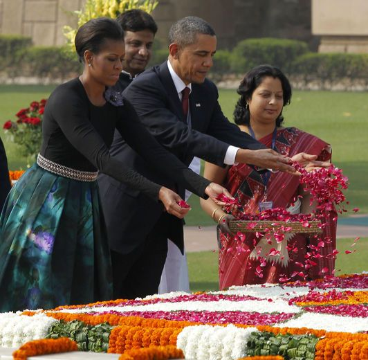 11/8/10: President Barack Obama and First Lady Michelle Obama sprinkle flower petals after laying a wreath at Raj Ghat in New Delhi, India.