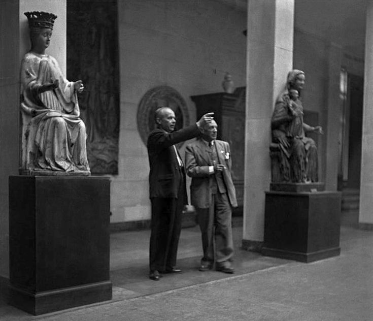 Stanisław Lorentz guides Pablo Picasso through the National Museum in Warsaw in Poland during exhibition Contemporary French Painters
