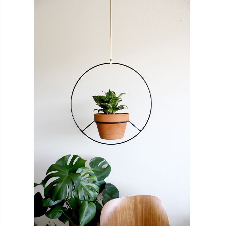 This black metal hanging planter is the epitome of modernist simplicity. In general, I'm obsessed with hanging everything in my house from the ceiling. Plants, chairs, lamps, tables...everything is fa