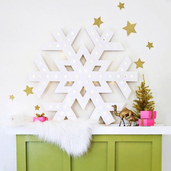 Learn how to make this giant snowflake light-up marquee! We show you how to make a wood version or a foam core version. So easy!