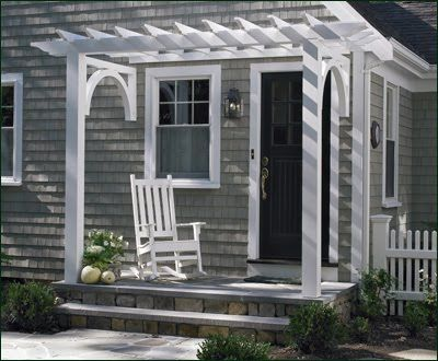 junkgarden blog - this kind of trellis/pergola would be neat over garage and at porch door on side of house.