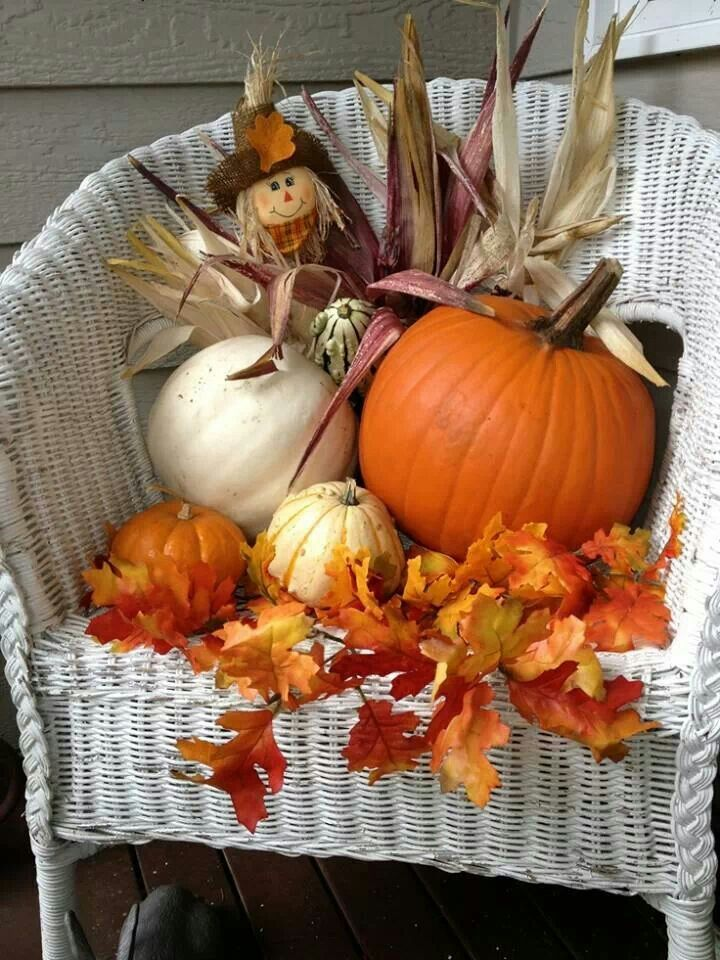 fall pumpkins and autumn leaves decor for the porch in a white wicker chair - Fall Pumpkin Decorations