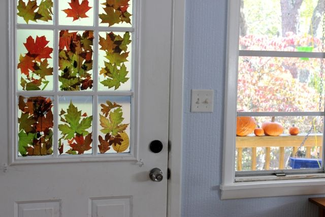 Make this autumn leaves craft by turning colorful fall foliage into a beautiful stained glass window that brings seasonal color indoors.