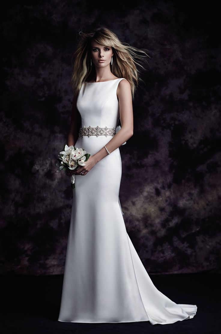 View our Satin Bateau Wedding Dress - Style #4614 from Paloma Blanca. All Satin gown with bateau neckline. Fit and flare skirt. Chapel Train.