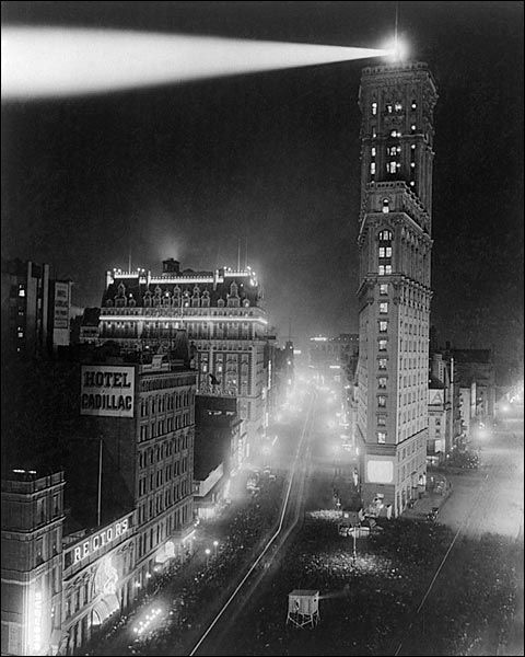 New York City Times Square,  New Years Day 1908:  Photo of the first year that the illuminated ball was dropped from atop the New York Times Building. It was actually dropped one minute after midnight.