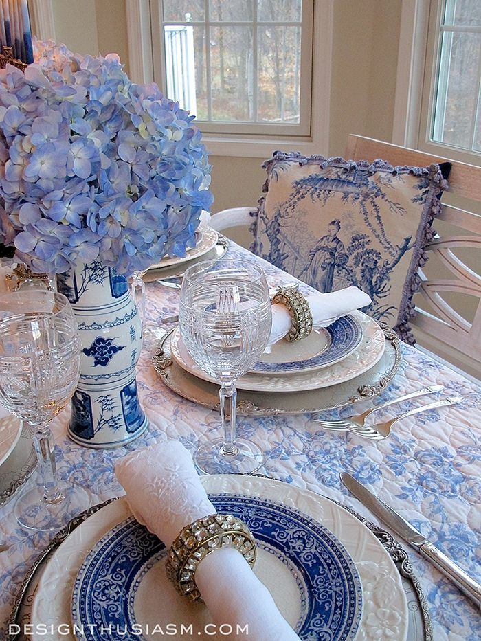 Blue and white is one of the most romantic color palettes for the home.  Whether it's French blue toile, homespun country checks or elegant blue and white chinoiserie, the combination suits many tastes and aesthetic styles.  Here it's used in a holiday table setting | Designthusiasm.com #frenchcountry #holidaytable #hanukkah