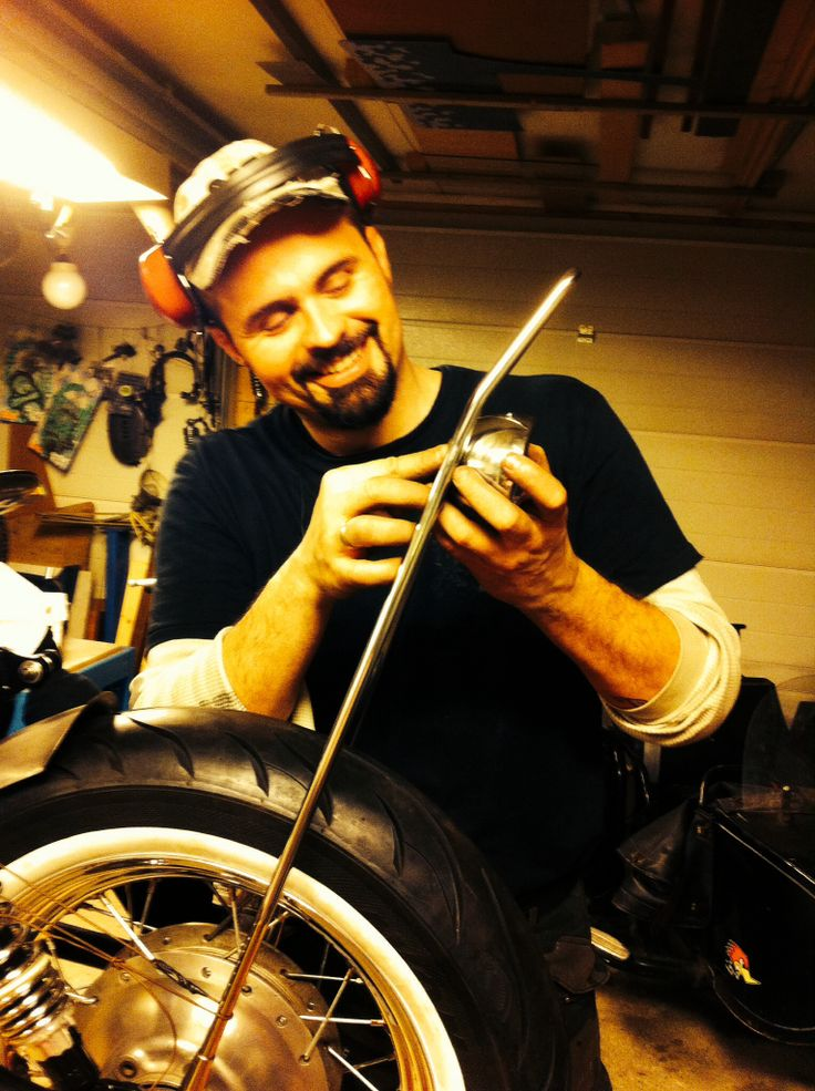 My husband in action making my sissy bar. Xs650 bobber