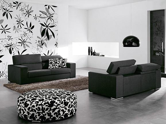 Composizione divano 3 posti + 2 posti con poggiatesta reclinabile in tessuto nero.