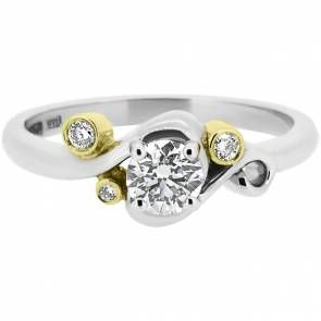 Bespoke engagement ring inspired by Vincent van Gogh's 'Starry night'. Made in certified Fairtrade 18ct white and yellow golds, and set with round brilliant Canadian diamonds.