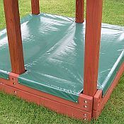 Looking for a Custom Sandbox Cover to fit the sandbox on your existing swing set or fort? MightyCovers.com can make your custom sandbox cover to nearly any size that you may need. Only the best materials are used to make these covers, including 11oz mesh and 15 oz marine grade tri-laminated vinyl with reinforced cut-outs (see photo on right). Your choice of pre-sewn in stainless steel snaps or grommets make for easy attachment. You may also opt for no fasteners.