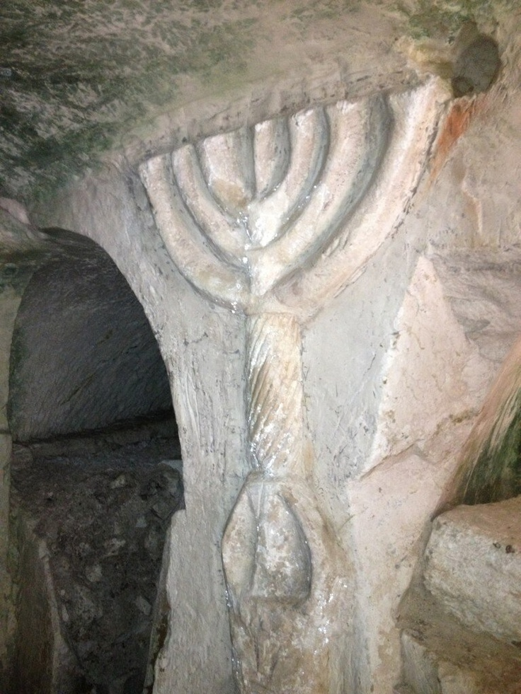 Ancient cave carving of Temple lamp stand (menorah).