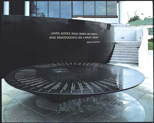 Civil Rights Memorial at the Southern Poverty Law Center in Montgomery, Alabama, designed by Maya Lin.  The names at the top of the circle are those who lost their lives in the fight for civil rights.  Water flows over the names and down off the sides.