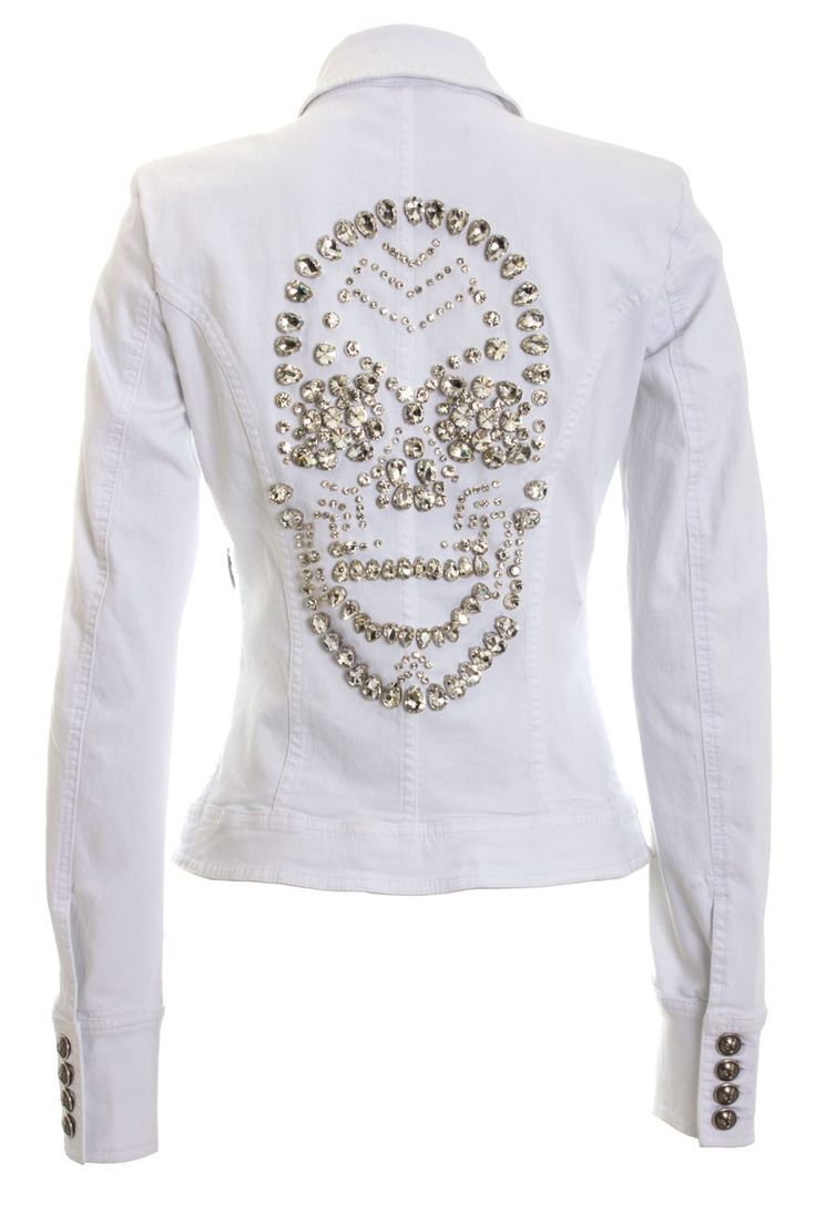 White cotton blend denim jacket from Philipp Plein featuring a classic collar, a front button fastening, long sleeves and button cuffs, chest pockets and a crystal studded skull design to the rear.  Philipp Plein is pure luxury with his latest Womenswear Collection embodying the designers rebel streak and glamourous ideals, making the Philipp Plein brand instantly recognisable.  SS14-CW212349
