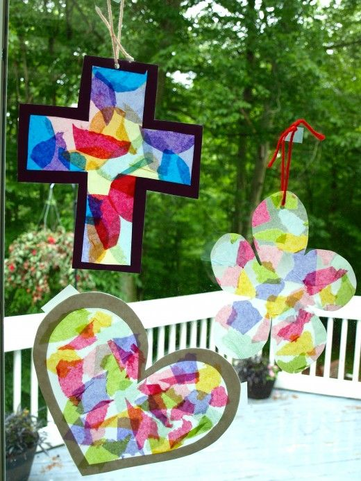 Easy sun catcher craft projects for kids. two sheets of contact paper. multi-colored pack of tissue paper. direction on site for bordered sun catcher also.