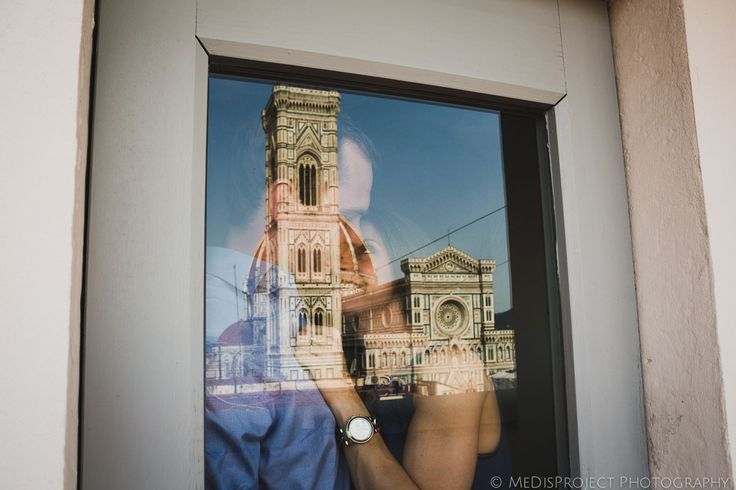 couple at the window in front of florence cathedral