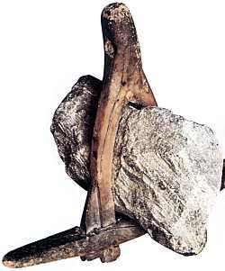 Anchor - Anchors were usually made from stone lashed into a wooden frame (left). The anchor shown (from Denmark) is made entirely of iron and is about 1.5m (5ft) in the long dimension. Some of the more elaborate anchors that have been found use an iron bound wooden shank and have iron rings to accommodate the cable.