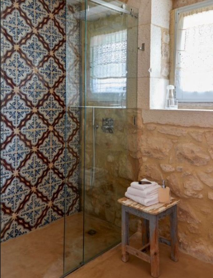 "This beautifully tiled shower is from our feature ""Earthy Oasis"""