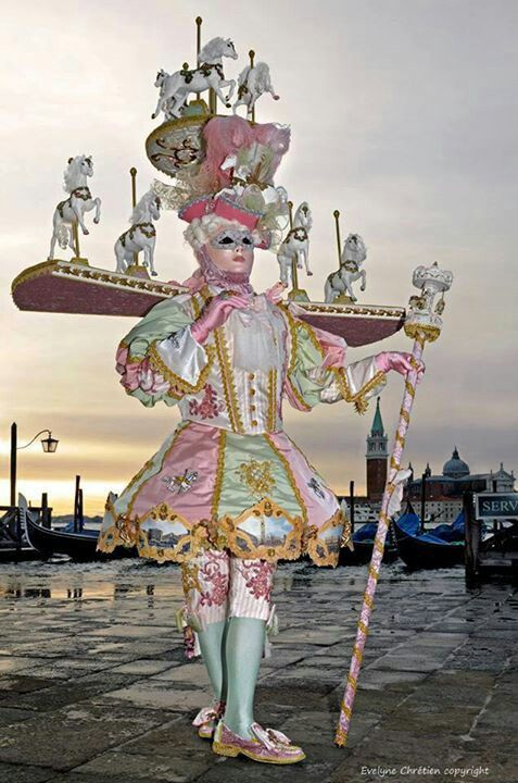 I want this to be my new job: wearing fantastical costumes and posing in them at sunrise in the town square.