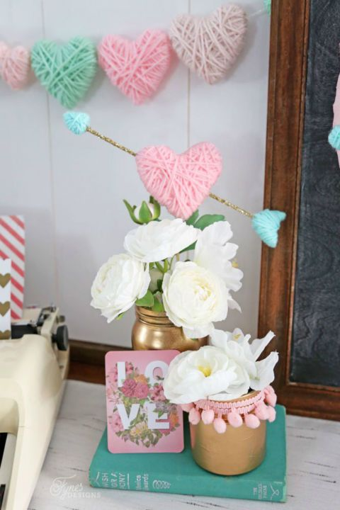 Yarn Wrapped Hearts: Not only is this cute V-Day decoration easy to make,  it can also be reused again and again. Click through to find more DIY Valentine's Day decorations for your home.