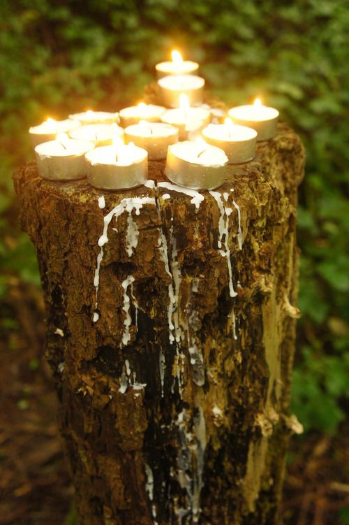 Tree stump with candles melting on it, centerpiece?