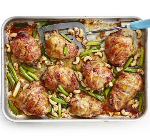 Sticky Chinese chicken traybake:     Slash 8 skin on and bone in chicken thighs. Mix 4 tbs hoisin sauce, 2 tsp sesame oil, 2 tbs clear honey, 1½ tsp Chinese five-spice powder, thumb-sized knob of ginger and 2 garlic cloves, grated, s&p; pour over chicken. Marinate 2-12 hours, roast at 180C 35 min, basting 1-2 times. Add a chopped bunch spring onions and 50g toasted cashews; cook 5-10 min. Serve with brown rice.   BBC goodfood