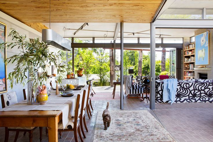 """Ariane's adaptable home in Perth:The marri ceiling timbers above the open-plan dining area were cut from the owners' property near Margaret River. The dining table was once a baker's kneading surface.   **Tablecloth** and **throws** from [Pure Linen](http://www.purelinen.com.au/?utm_campaign=supplier/