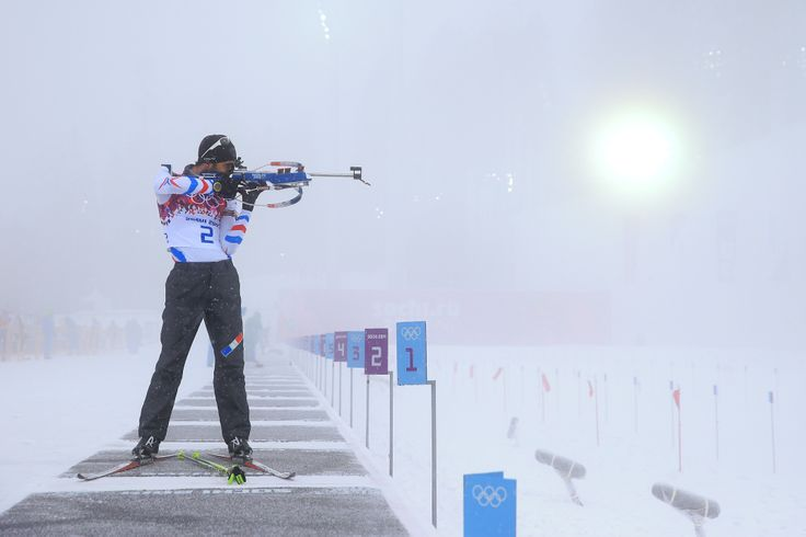 Martin Fourcade of France practises at the shooting range in foggy conditions before the Men's 15 km Mass Start (c) Getty Images