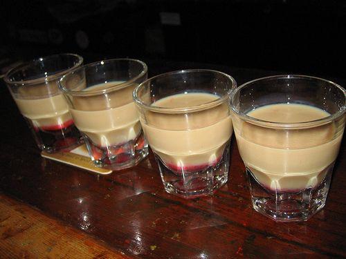 Slippery Nipple Shots.   Recipe:  1 1/2 oz. Sambuca  1/2 oz. Irish Cream  Single drop of grenadine