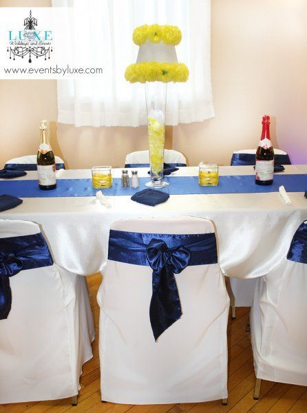 Royal blue and yellow wedding decor, blue chair sashes and blue runners, yellow centerpiece wedding ideas