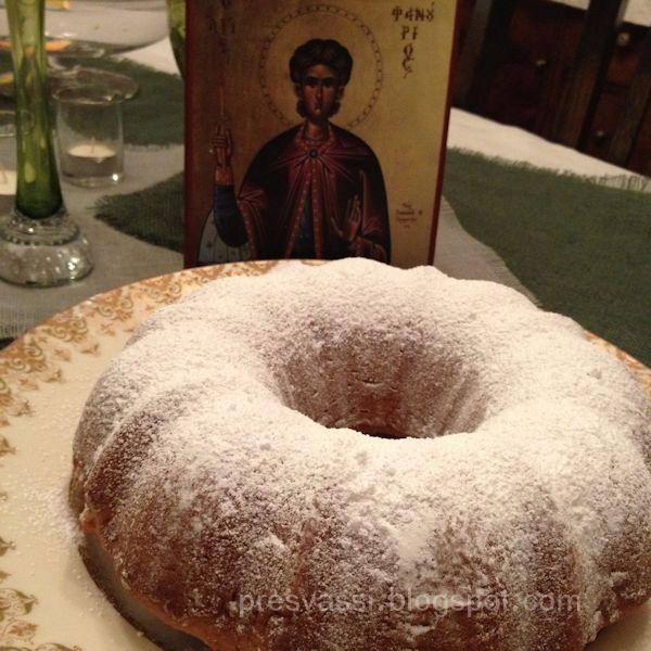 Phanouropita dusted with powdered sugar next to icon of St. Phanourios