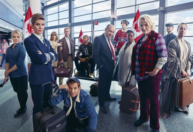 The cast of Come from Away: Kendra Kassebaum, Jenn Colella, Sharon Wheatley, Lee MacDougall, Chad Kimball, Rodney Hicks, Joel Hatch, Petrina Bromley, Q. Smith, Astrid Van Wieren, Geno Carr, and Caesar Samayoa; photographed at the Staten Island Ferry Whitehall Terminal, in New York City. Photohgraph by Mark Seliger.