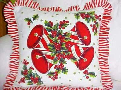 Looove it!! Made from a vintage Christmas table cloth!! Country Christmas is always Bells and Candy Canes to me!!!!