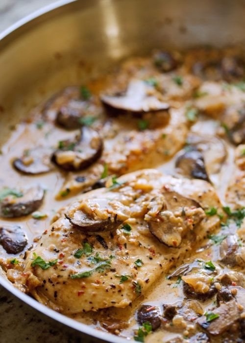One Skillet chicken dinner that's easy to make with only a few ingredients. Pan seared chicken breast drizzled in a sautéed mushroom and garlic cream sauce.