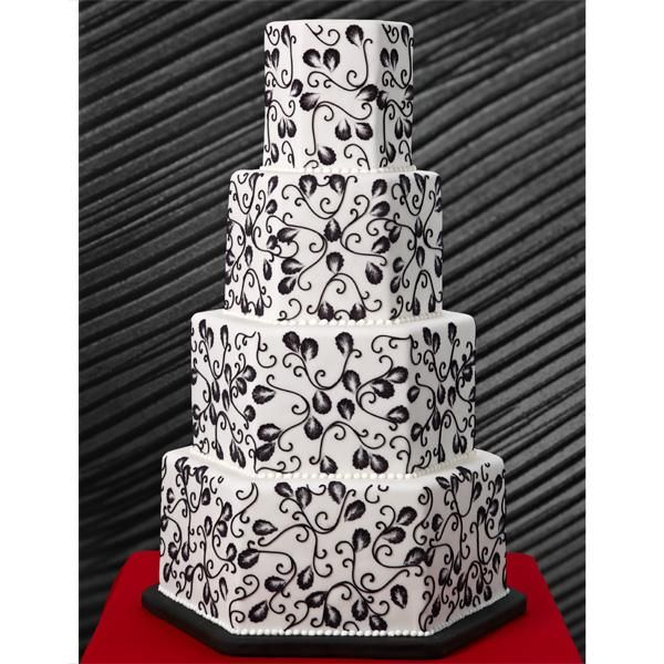 Black floral, white fondant and a memorable hexagon shape make a striking and sophisticated combination on this four-tiered wedding cake. Wilton Black Ready-To-Use Rolled Fondant makes it easy to decorate without the need for tinting fondant.