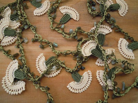 Long lariat flower necklace. It consists of 24 hand crocheted carnations. They are crocheted together with natural stone beads and green thread.