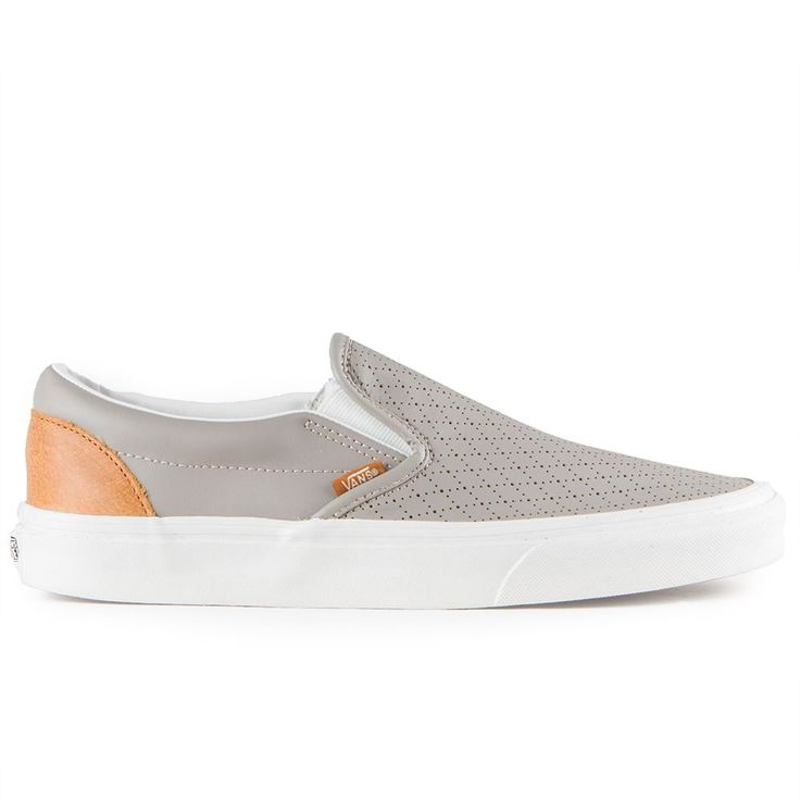 The Vans Classics Slip-On Men's Shoes in the (Perf Leather) Moon Rock/Cashew Colorway feature low profile slip-on uppers made with perforated leather, padded collars, elastic side accents, and signatu
