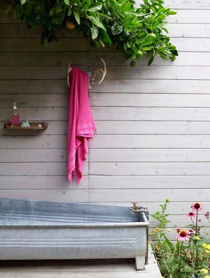 Love the tub and antler towel hook.  Los Feliz Cottage by Alexandra Angle | Remodelista
