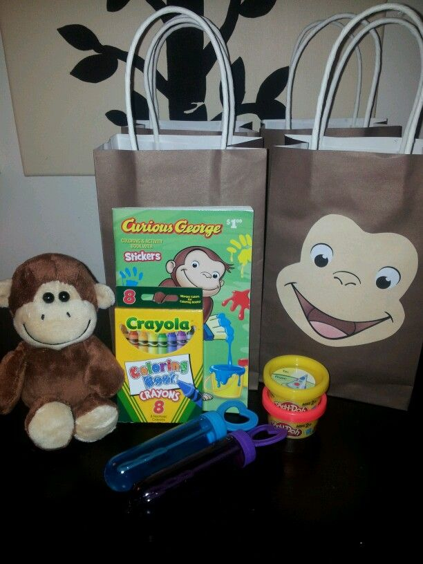 Party favors | Small stuffed monkey, Curious George coloring book, crayons, bubbles & mini playdough. Printed out Curious George face & glued onto brown gift bag.