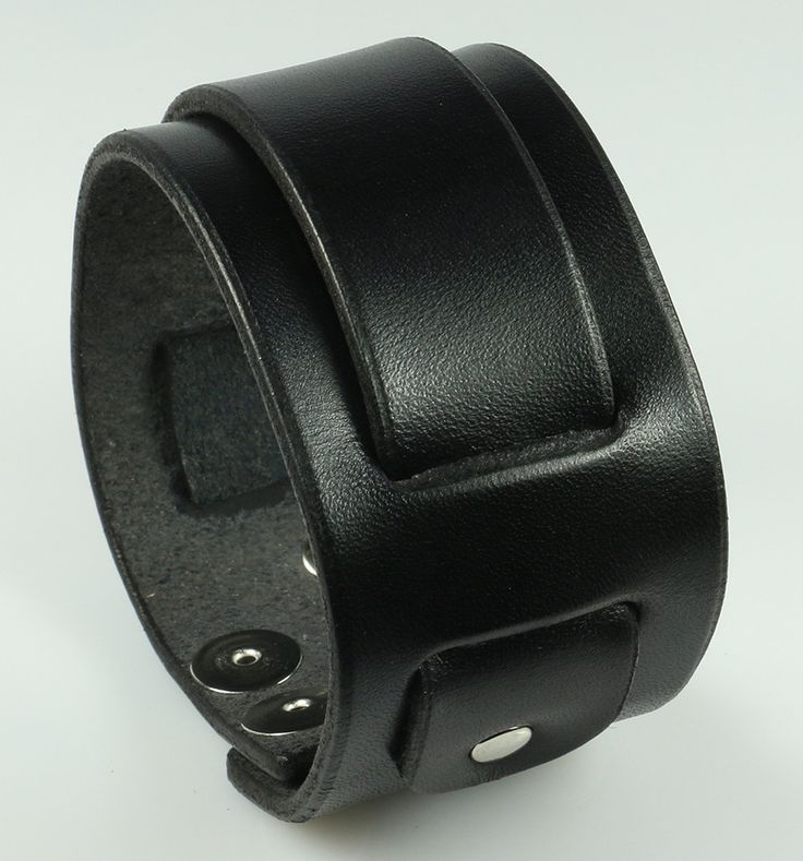 "Iconic LP skater punk wristband. Base strap is 1.75"" wide, center strap is 1"" wide and weaves through a series of oblong slits fastened by chrome rivets. Snap closures. This is a long standing favorit"