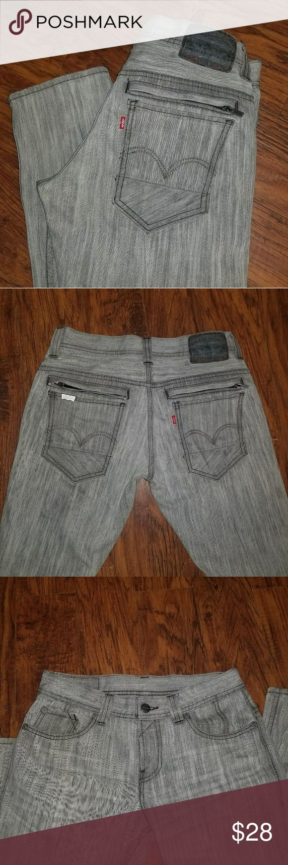 Levis 511 Skinny Trendy Levis 511 Skinny jeans in EUC. Antique silver hardware, red tab on back pocket, 2 extra zipper pockets on seat of pants. They are gray in color with no fraying. The size on these is 29×30 Levi's Jeans Skinny