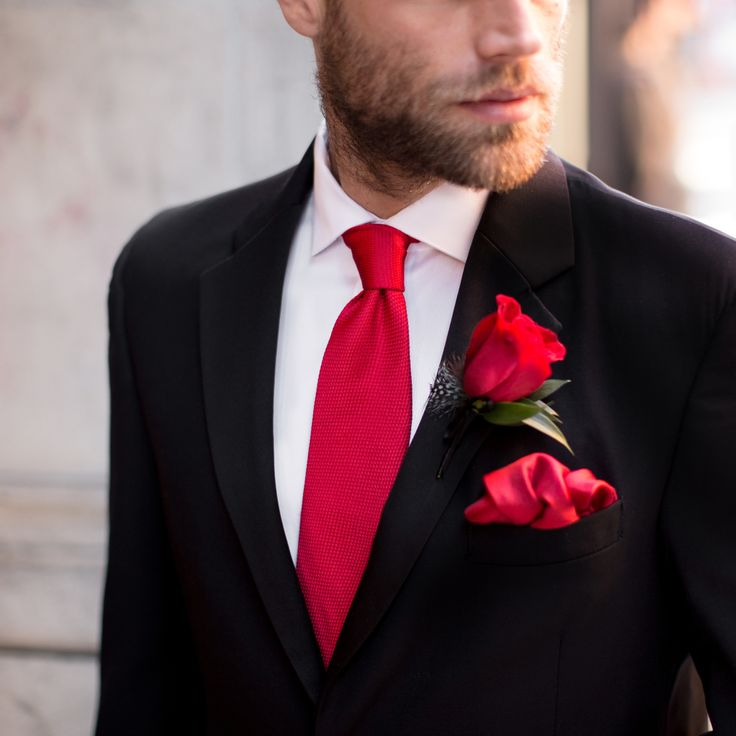 Style tip: Trim your classic black tuxedo with romantic pops of red ties and boutonnieres for ultimate elegance. #MensWearhouse